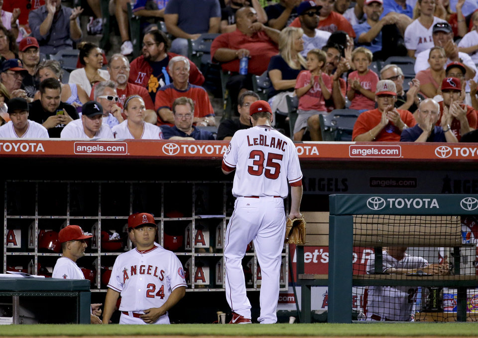 Photo - Los Angeles Angels starting pitcher Wade LeBlanc leaves the baseball game against the Miami Marlins during the fourth inning in Anaheim, Calif., Monday, Aug. 25, 2014. (AP Photo/Chris Carlson)