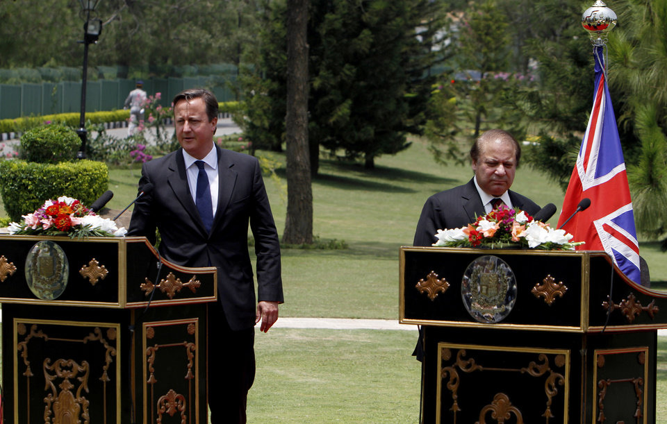 Photo - British Prime Minister David Cameron, left, with his Pakistani counterpart Nawaz Sharif arrive for joint press conference in Islamabad, Pakistan, Sunday, June 30, 2013. Cameron is in Islamabad on a tow-day visit to hold talks with Pakistani top leaders on bilateral interest, regional and international importance including the peace process in Afghanistan. (AP Photo/Anjum Naveed)