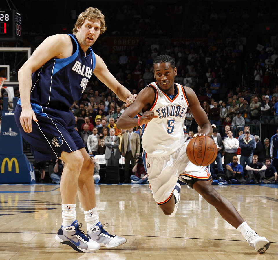 Oklahoma City's Kyle Weaver (5) drives past Dirk Nowitzki (41) of Dallas in the first half during the NBA basketball game between the Dallas Mavericks and the Oklahoma City Thunder at the Ford Center in Oklahoma City, March 2, 2009. BY NATE BILLINGS, THE OKLAHOMAN