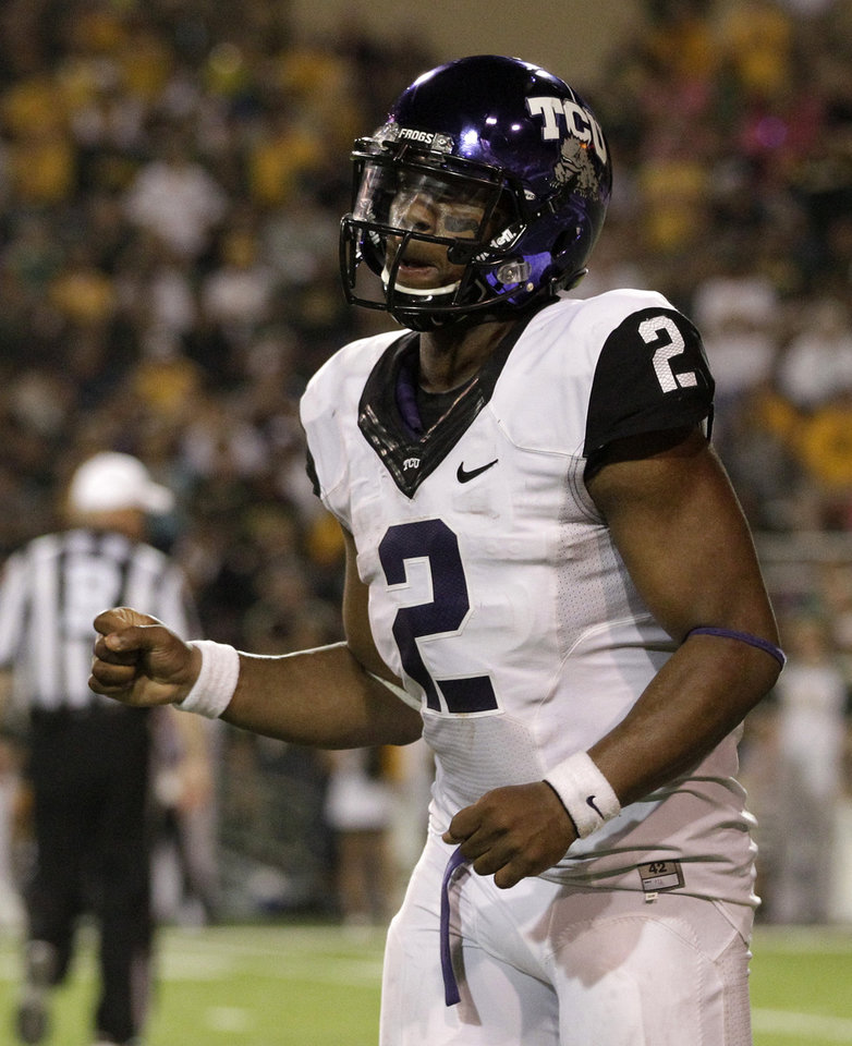 Photo -   TCU quarterback Trevone Boykin (2) pumps his fist as he heads to the bench after his team scored late in the second half of an NCAA college football game against Baylor, Saturday, Oct. 13, 2012, in Waco, Texas. TCU defeated Baylor 49-21. (AP Photo/Tony Gutierrez)