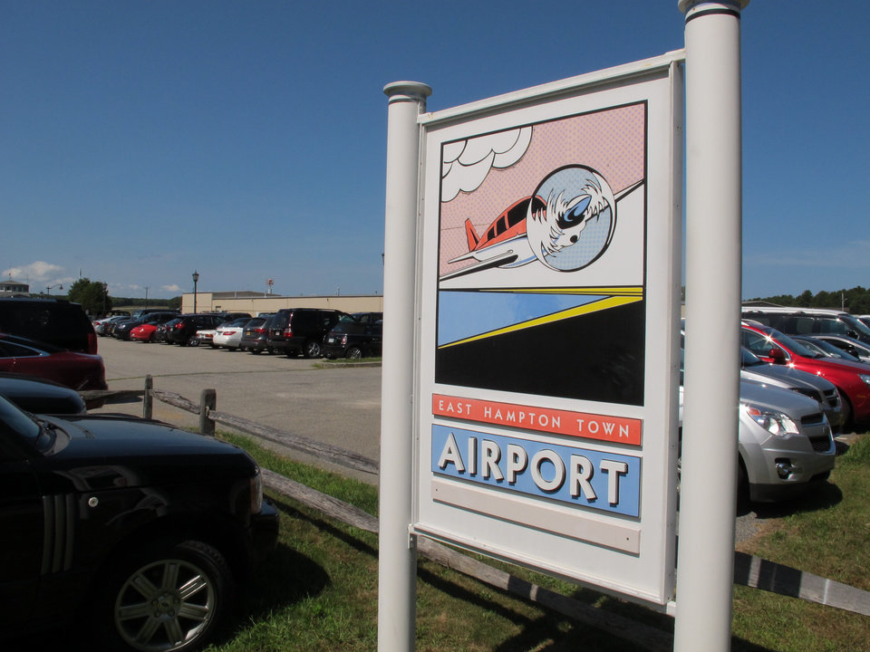 Photo - In this Wednesday, Aug. 20, 2014 photo, a sign welcomes visitors to the East Hampton Town Airport. Residents across eastern Long Island are complaining about the noise generated from jets, helicopters and other aircraft that land at the small municipal airport, which is situated in the heart of the summer playground for the rich and famous. (AP Photo/Frank Eltman)