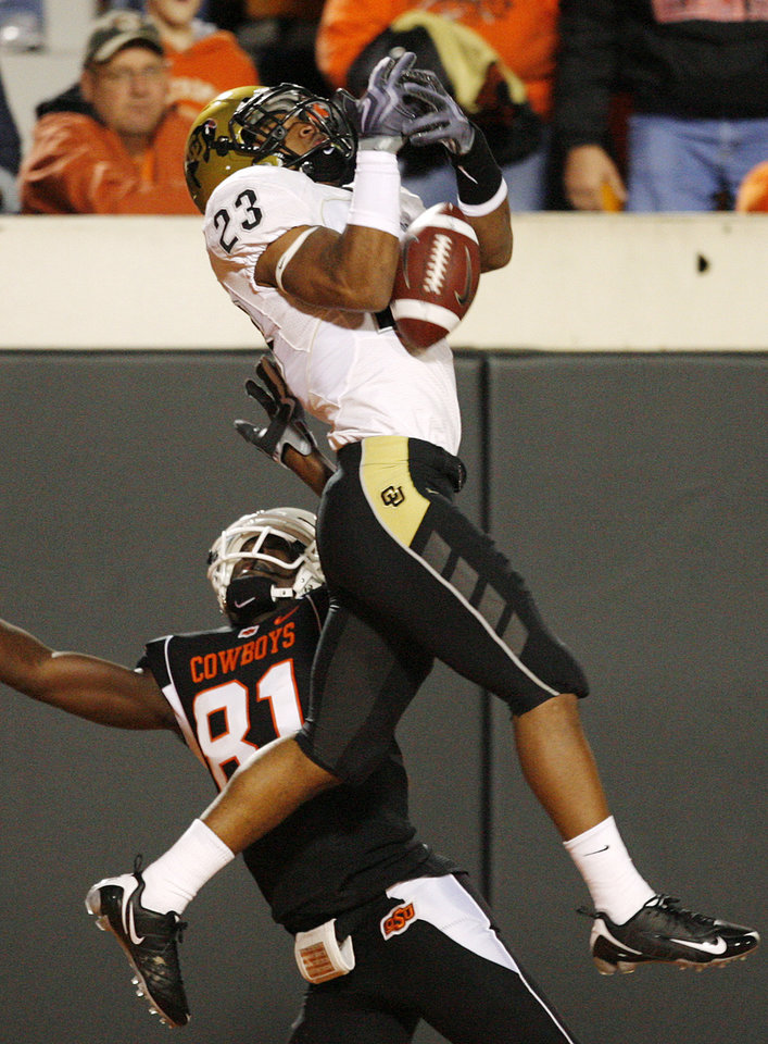 Photo - Colorado's Jalil Brown (23) nearly intercepts a pass intended for OSU's Justin Blackmon (81) in the second quarter during the college football game between Oklahoma State University (OSU) and the University of Colorado (CU) at Boone Pickens Stadium in Stillwater, Okla., Thursday, Nov. 19, 2009. Photo by Nate Billings, The Oklahoman