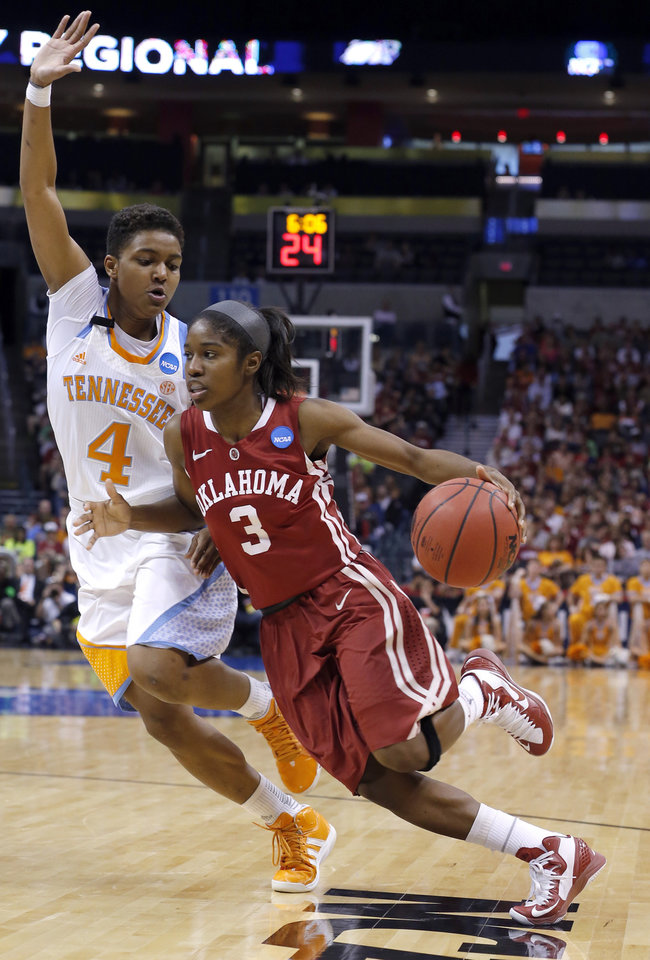 Photo - Oklahoma's Aaryn Ellenberg (3) drives past Tennessee's Kamiko Williams (4) during the college basketball game between the University of Oklahoma and the University of Tennessee at the  Oklahoma City Regional for the NCAA women's college basketball tournament at Chesapeake Energy Arena in Oklahoma City, Sunday, March 31, 2013. Photo by Sarah Phipps, The Oklahoman