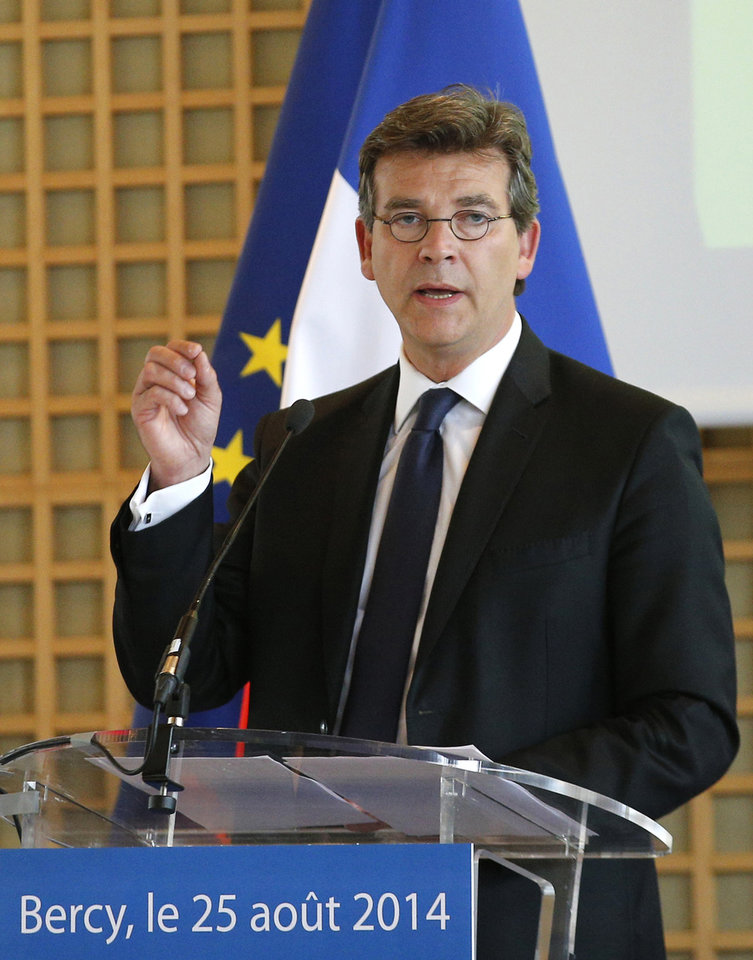Photo - Economy Minister Arnaud Montebourg gestures during a press conference in Paris, Monday, Aug.25, 2014. France's Socialist government dissolved on Monday after open feuding in the Cabinet over how much cutting _ or spending _ will revive the country's stagnant economy. The country is under pressure from the 28-nation European Union to get its finances in order, but Economy Minister Arnaud Montebourg has questioned whether austerity will really kick start French growth.  (AP Photo/Christophe Ena)