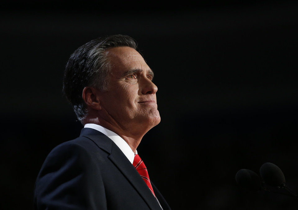 Photo -   Republican presidential nominee Mitt Romney acknowledges delegates before speaking at the Republican National Convention in Tampa, Fla., on Thursday, Aug. 30, 2012. (AP Photo/Jae C. Hong)