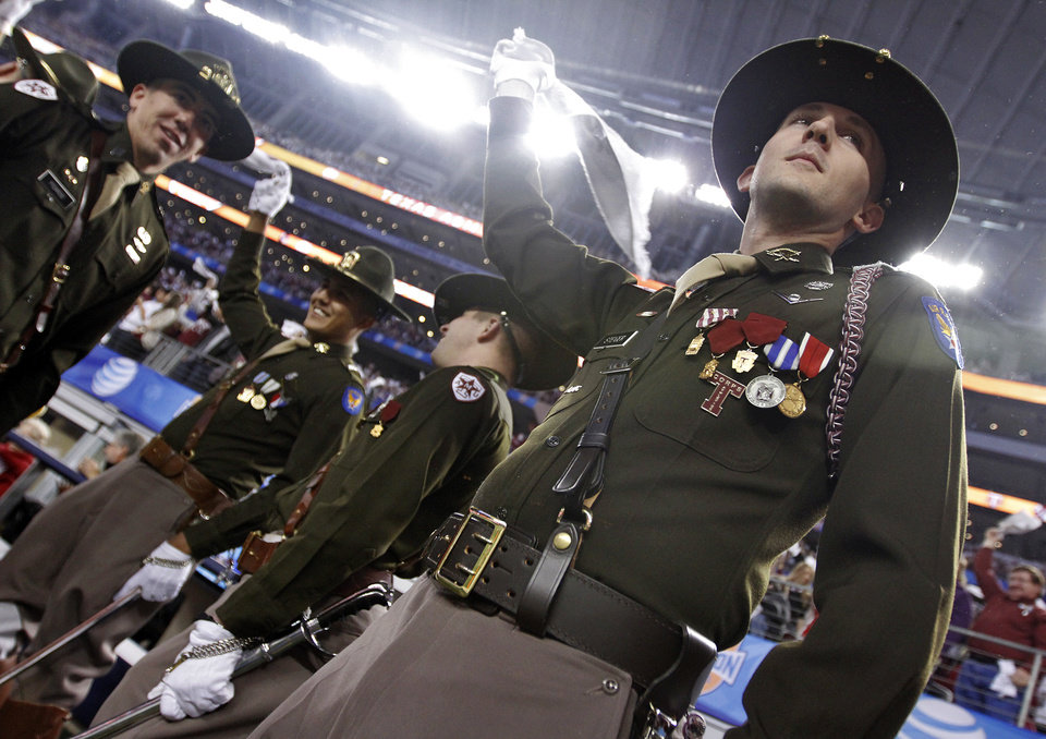 Members of the Corps of Cadets wave towels during the college football Cotton Bowl game between the University of Oklahoma Sooners (OU) and Texas A&M University Aggies (TXAM) at Cowboy\'s Stadium on Friday Jan. 4, 2013, in Arlington, Tx. Photo by Chris Landsberger, The Oklahoman