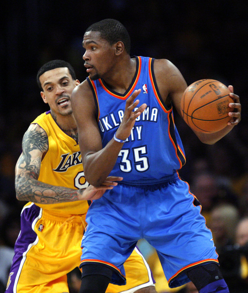 Oklahoma City's Kevin Durant (35) tries to get by Los Angeles' Matt Barnes (9) during Game 3 in the second round of the NBA basketball playoffs between the L.A. Lakers and the Oklahoma City Thunder at the Staples Center in Los Angeles, Friday, May 18, 2012. Photo by Nate Billings, The Oklahoman