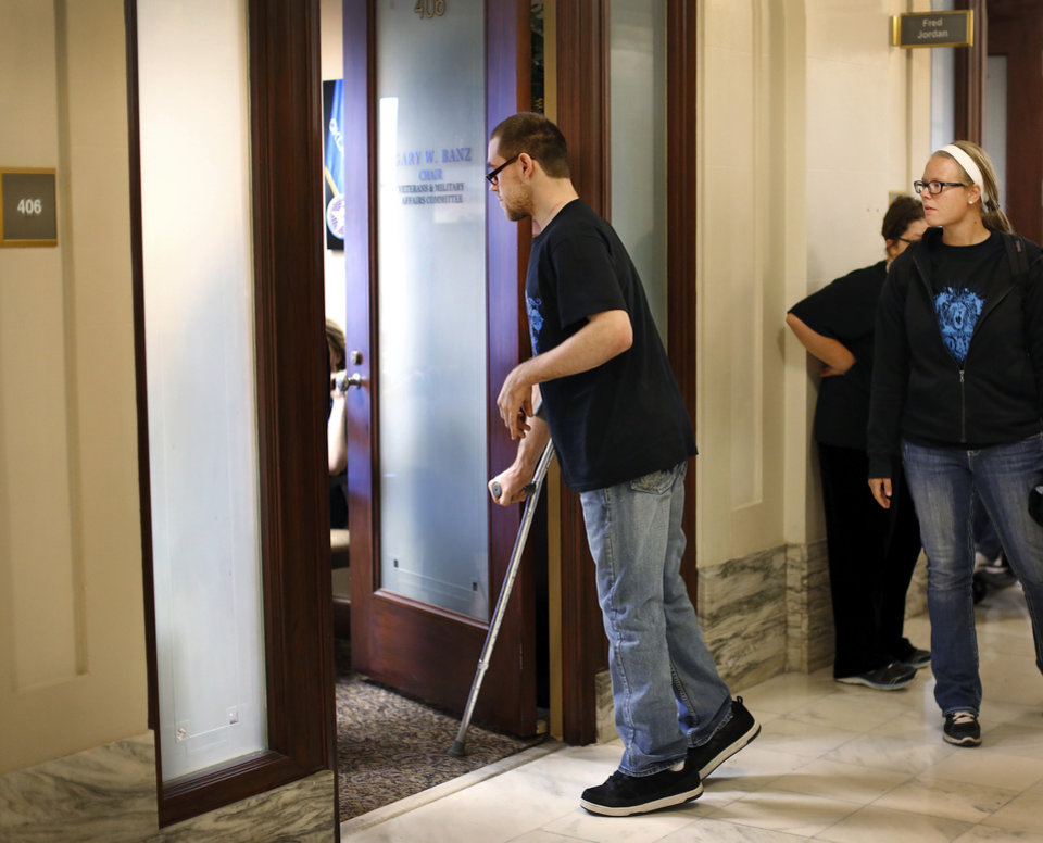 Photo -  Sky Huff, of Muskogee, walks into the office of Rep. Gary Banz on the fourth floor of the state Capitol. More than 700 people crowded the Capitol on Thursday to rally for the developmentally disabled. Photo by Jim Beckel, The Oklahoman   Jim Beckel -