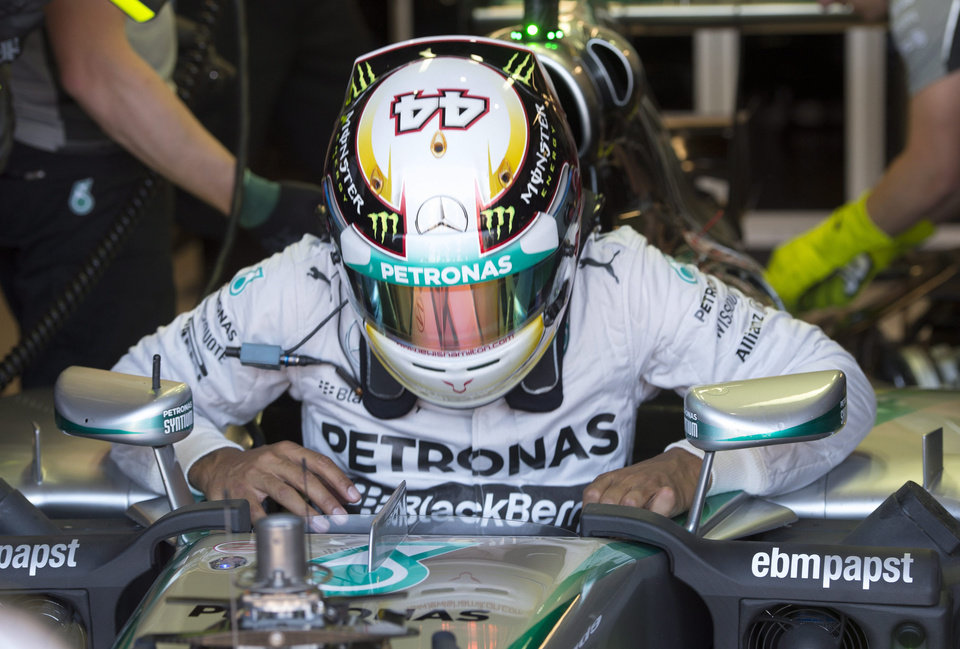 Photo - Mercedes driver Lewis Hamilton from Great Britain gets out of his car during the third practice session at the Canadian Grand Prix Saturday, June 7, 2014 in Montreal. (AP Photo/The Canadian Press,  Paul Chiasson)