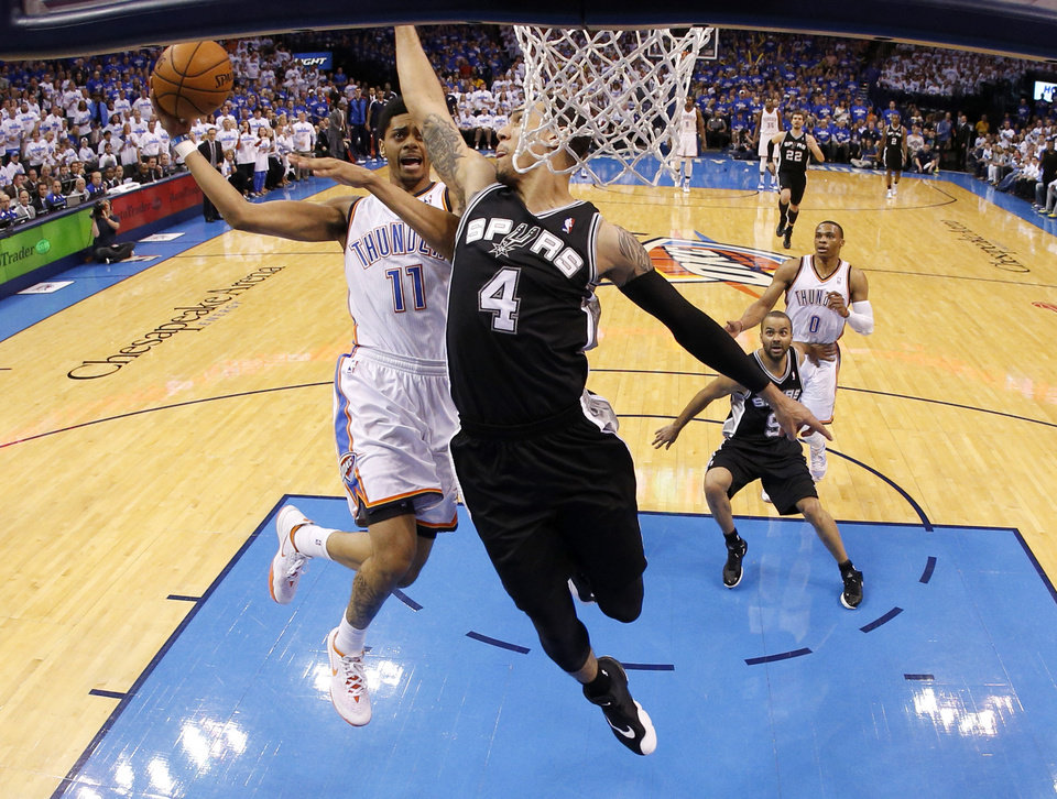 Photo - Oklahoma City's Jeremy Lamb (11) drives to the basket beside San Antonio's Danny Green (4) during Game 4 of the Western Conference Finals in the NBA playoffs between the Oklahoma City Thunder and the San Antonio Spurs at Chesapeake Energy Arena in Oklahoma City, Tuesday, May 27, 2014. Photo by Bryan Terry, The Oklahoman