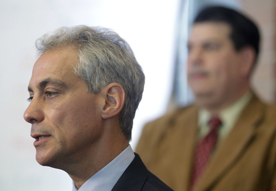 Photo -   Chicago Mayor Rahm Emanuel speaks during a news conference at Tarkington School of Excellence in Chicago, Tuesday, Sept. 11, 2012 as Vincent Iturralde, right, principal at at Tarkington listens. Negotiations continue on the second day of a strike in the nation's third-largest school district, as the two sides continue to struggle to reach an agreement in a bitter contract dispute over evaluations and job security. (AP Photo/M. Spencer Green)