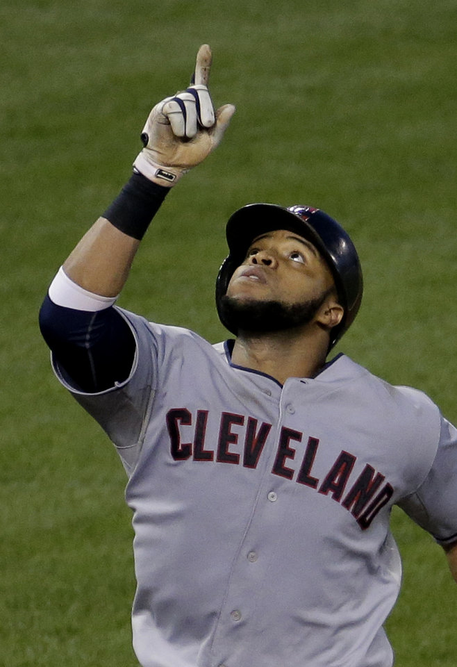 Photo - Cleveland Indians' Carlos Santana celebrates as he crosses the plate after hitting a two-run home run during the sixth inning of a baseball game against the Kansas City Royals, Friday, July 25, 2014, in Kansas City, Mo. (AP Photo/Charlie Riedel)