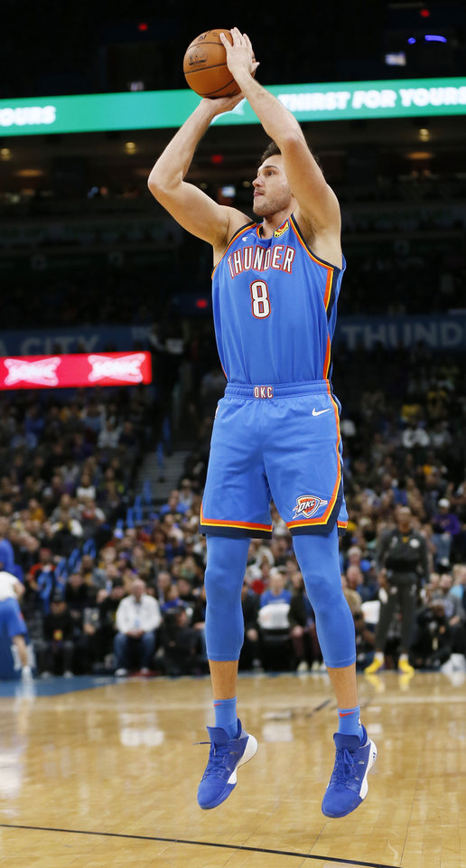Photo - Oklahoma City's Danilo Gallinari (8) shoots a three-point shot in the first quarter during an NBA basketball game between the Oklahoma City Thunder and the Los Angeles Lakers at Chesapeake Energy Arena in Oklahoma City, Friday, Nov. 22, 2019. [Nate Billings/The Oklahoman]