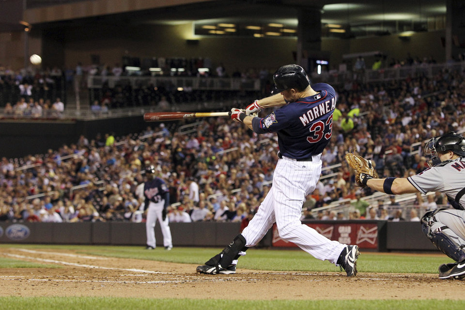 Photo -   Minnesota Twins' Justin Morneau (33) hits a sacrifice fly to score Alexi Casilla against Cleveland Indians starting pitcher Justin Masterson during the fourth inning of a baseball game, Monday, Sept. 10, 2012, in Minneapolis. Indians Lou Marson catches at right.(AP Photo/Genevieve Ross)