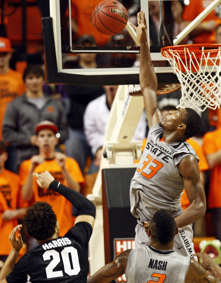 Photo - Oklahoma State's Marcus Smart (33) blocks a shot by Gonzaga's Elias Harris (20) as Oklahoma State's Le'Bryan Nash (2) looks on during a men's college basketball game between Oklahoma State University (OSU) and Gonzaga at Gallagher-Iba Arena in Stillwater, Okla., Monday, Dec. 31, 2012. Gonzaga won, 69-68. Photo by Nate Billings, The Oklahoman