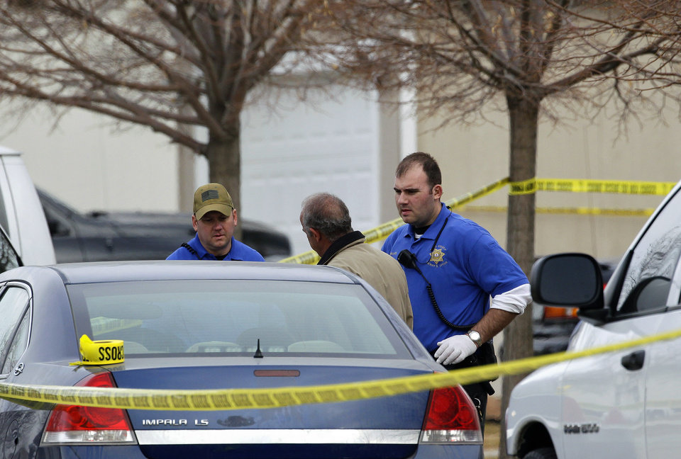 Police investigators work at the scene of an apparent murder-suicide, which officials say left four dead inside a home, according to officials, in Longmont, Colo., Tuesday Dec. 18, 2012.  Weld County sheriff�s spokesman Tim Schwartz says dispatchers heard the woman who called 911 scream �No, no, no,� and then they heard a gunshot. Schwartz says a man grabbed the phone and said he was going to kill himself, and dispatchers heard another shot.  (AP Photo/Brennan Linsley)
