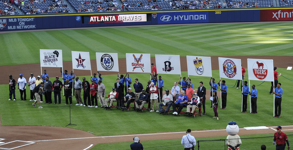 Photo - Members of the Negro League baseball teams from years past are honored before the start of a baseball game pitting the San Francisco Giants against the Atlanta Braves, Saturday, May 3, 2014, in Atlanta. (AP Photo/John Amis)