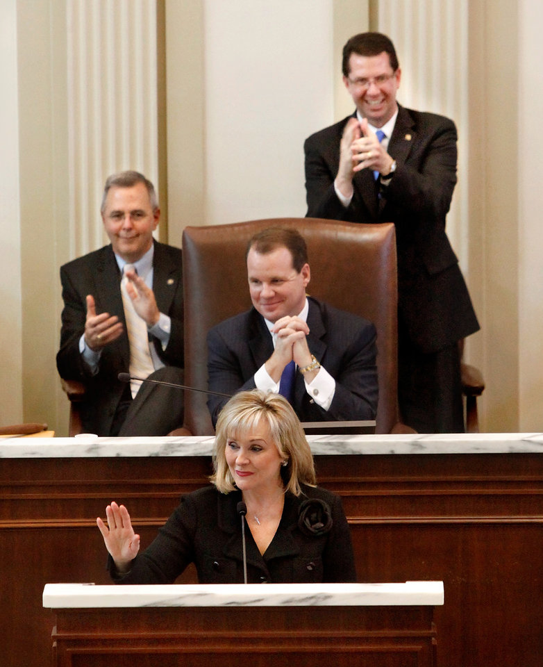 Photo - Gov. Mary Fallin delivers her 2012 State of the State address to a joint session of the Oklahoma legislature in the House Chamber on the opening day of the session, Monday, Feb, 6, 2012. Applauding are legislative leaders, from left, President Pro Tempore of the SenateBrian Bingman,   Lt. Gov. Todd Lamb and House Speaker Kris Steele.   Photo by Jim Beckel, The Oklahoman