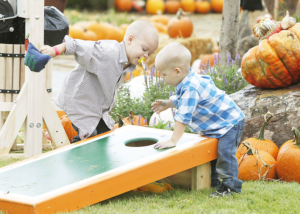CHILD / CHILDREN / KIDS: Brothers Aaden Thornburg, 4, and Aim Thornburg, 2, play bean bag toss at Pumpkinville at the Botanical Gardens in Oklahoma City, OK, Saturday, October 13, 2012,  By Paul Hellstern, The Oklahoman Archives <strong>PAUL HELLSTERN - Oklahoman</strong>