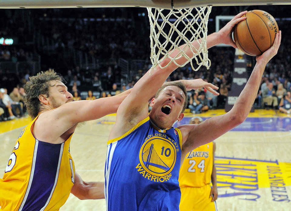 Photo -   Golden State Warriors forward David Lee, right, goes up for a shot as Los Angeles Lakers forward Pau Gasol, of Spain, defends during the first half of their NBA basketball game, Friday, Nov. 9, 2012, in Los Angeles. (AP Photo/Mark J. Terrill)