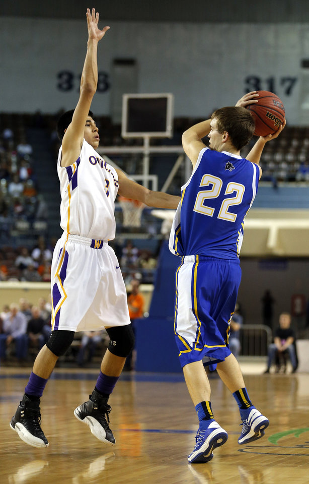 Glencoe\'s Jake Lazenby looks to pass the ball as Weleetka\'s Shaun Bencoma defends during the Class A boys state championship between Glencoe and Weleetka at the State Fair Arena., Saturday, March 2, 2013. Photo by Sarah Phipps, The Oklahoman