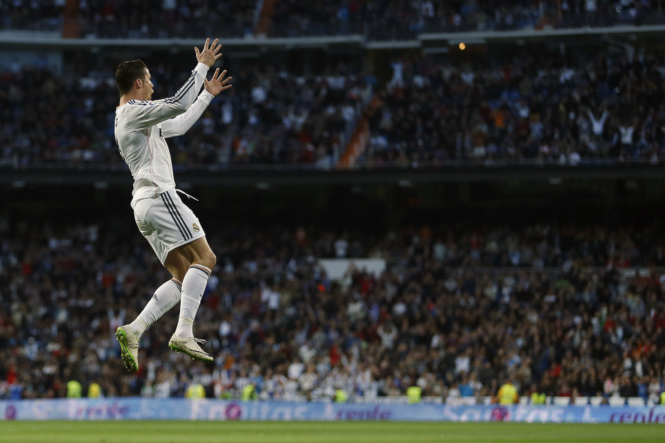 Photo - Real's Cristiano Ronaldo celebrates his goal during a Spanish La Liga soccer match between Real Madrid and Levante at the Santiago Bernabeu stadium in Madrid, Spain, Sunday, March 9, 2014. (AP Photo/Andres Kudacki)