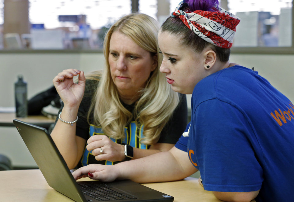 Photo -   EPIC Charter Schools teacher Regina Bell meets with student Lela Neumann, 16, of Norman, at the Norman Central Library. [OKLAHOMAN ARCHIVES PHOTO]