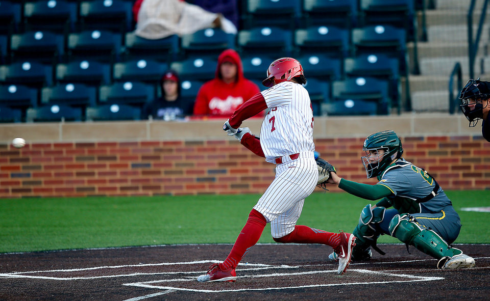Photo - OU's Kyler Murray hits a single in the first inning during a baseball game between the University of Oklahoma (OU) Sooners and Baylor, Thursday, March 29, 2018 in Norman, Okla. Photo by Sarah Phipps, The Oklahoman