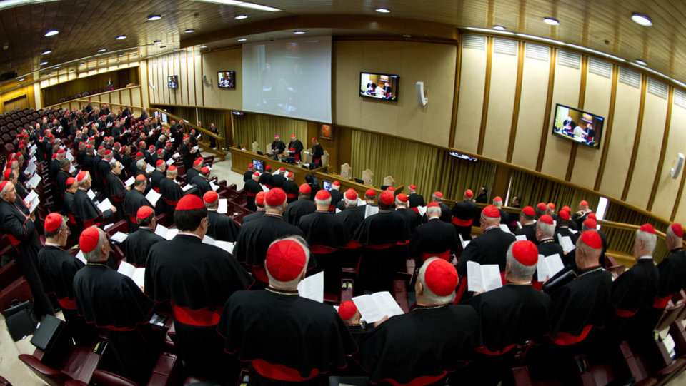 Photo - In this photo provided by the Vatican newspaper L'Osservatore Romano, cardinals attend a meeting, at the Vatican, Monday, March 4, 2013. Cardinals from around the world have gathered inside the Vatican for their first round of meetings before the conclave to elect the next pope, amid scandals inside and out of the Vatican and the continued reverberations of Benedict XVI's decision to retire. (AP Photo/L'Osservatore Romano, ho)
