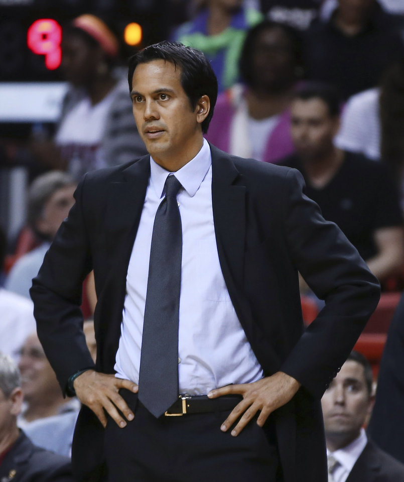 Photo - Miami Heat coach Erik Spoelstra watches during the first half of an NBA basketball game against the Memphis Grizzlies in Miami, Friday, March 21, 2014. (AP Photo/J Pat Carter)