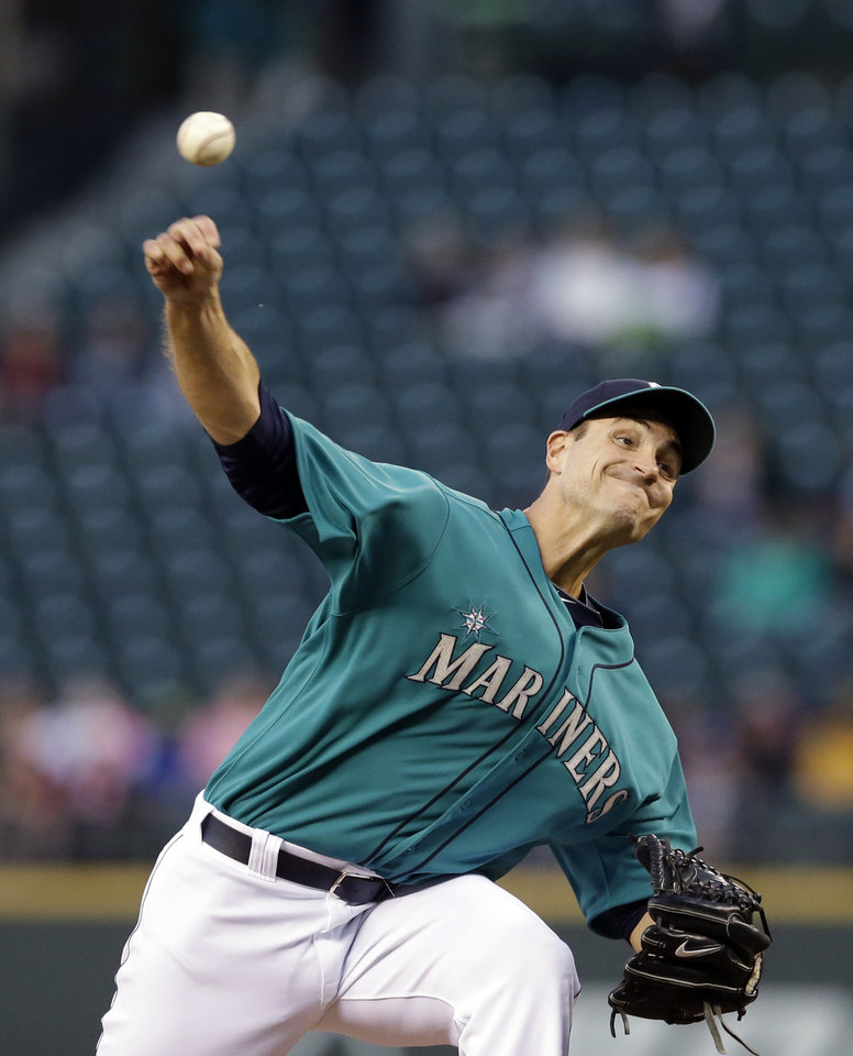 Photo - Seattle Mariners starting pitcher Chris Young throws against the San Diego Padres in the fifth inning in a baseball game Monday, June 16, 2014, in Seattle. (AP Photo/Elaine Thompson)