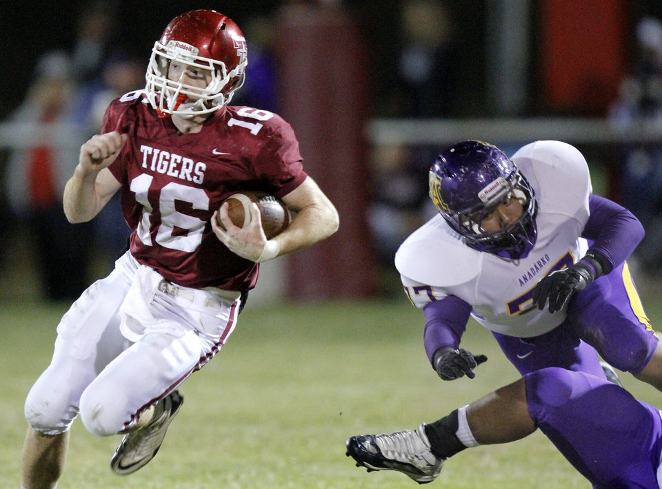 Tuttle's Tanner Koons gets past Anadarko's Dakota Botone during the high school football game between Tuttle and Anadarko, Friday, Oct. 29, 2010, in Tuttle, Okla. Photo by Sarah Phipps, The Oklahoman