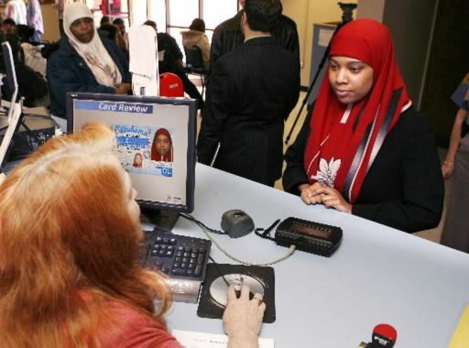 Monique Barrett has her photo taken for her driver's license with her traditional Muslim head scarf, at the Dept. of Public Safety in Oklahoma City, OK, Thursday, Feb. 19, 2009. By Paul Hellstern.