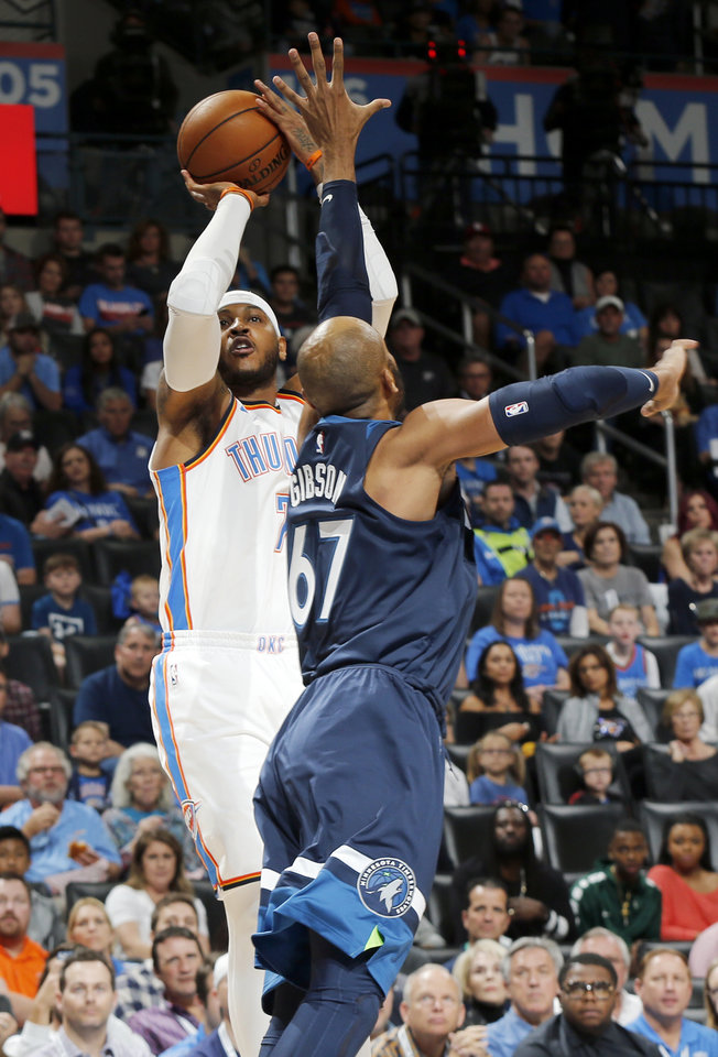 Photo - Oklahoma City's Carmelo Anthony (7) shoots as Minnesota's Taj Gibson (67) defends during an NBA basketball game between the Oklahoma City Thunder and the Minnesota Timberwolves at Chesapeake Energy Arena in Oklahoma City, Sunday, Oct. 22, 2017. Photo by Nate Billings, The Oklahoman