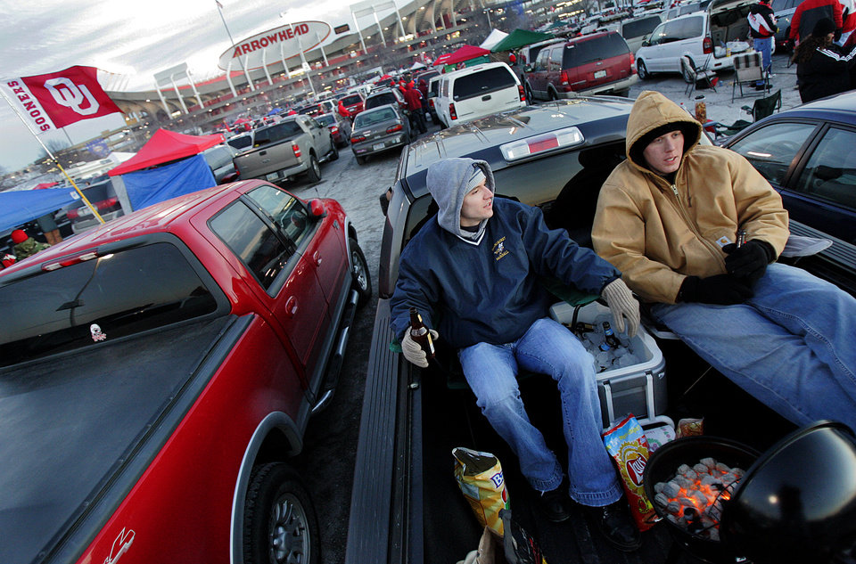 TAILGATING: Sooner fans for the day Chris Stowell and Matt Sewing, both of Missouri, tailgate in the back of their truck before the start of the Big 12 Championship game during the University of Oklahoma Sooners (OU) college football game against the University of Nebraska Cornhuskers (NU) at Arrowhead Stadium, on Saturday, Dec. 2, 2006, in Kansas City, Mo. by Chris Landsberger, The Oklahoman ORG XMIT: KOD