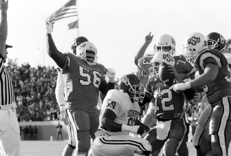 OSU quarterback Mike Gundy scores a touchdown during the University of Oklahoma (OU) at Oklahoma State University (OSU) Bedlam college football in Stillwater, Nov. 5, 1988. PHOTO BY JIM ARGO THE OKLAHOMAN