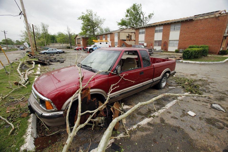 Damage is seen in an apartment parking lot on Saturday, April 14, 2012, in Norman, Okla.  West Oaks Apartments lost windows, walls and roof during Friday's tornado.  Photo by Steve Sisney, The Oklahoman
