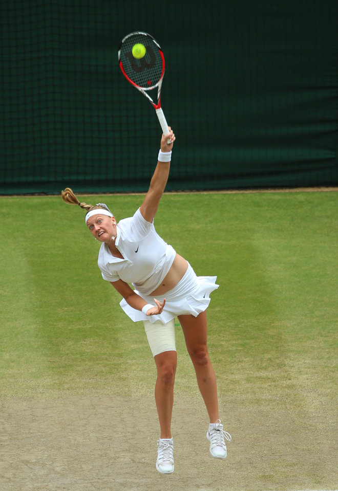 Photo - Petra Kvitova of Czech Republic serves to Eugenie Bouchard of Canada during the women's singles final at the All England Lawn Tennis  Championships at Wimbledon, London, Saturday, July, 5, 2014. (AP Photo/Gareth Fuller, Pool)