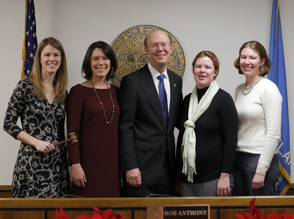 Oklahoma Corporation Commissioner Bob Anthony poses with his daughters, from left, Katherine Anthony, Suzanne Anthony, Christine Anthony and Elizabeth Anthony, following a swearing-in at the Jim Thorpe Building in Oklahoma City on Thursday. Photo by Sarah Phipps, The Oklahoman SARAH PHIPPS - SARAH PHIPPS