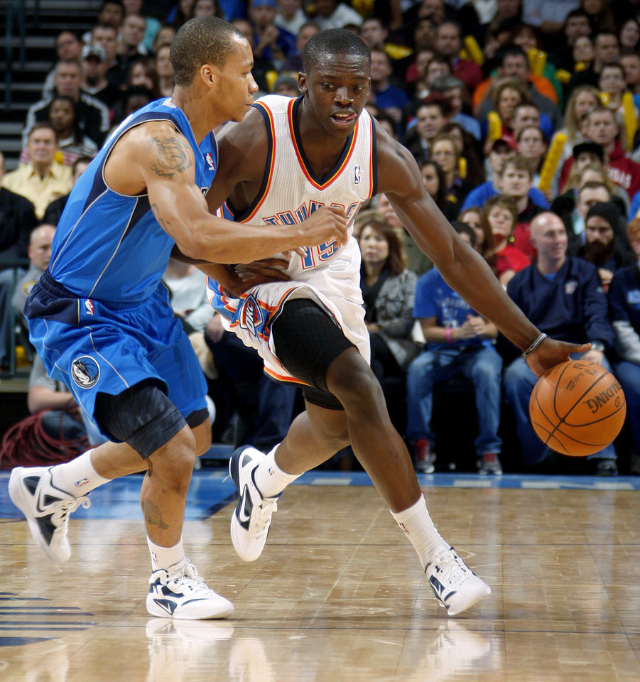 Photo - Oklahoma City's' Reggie Jackson (15) drives past Dallas' Jerome Randle (9) during a preseason NBA game between the Oklahoma City Thunder and the Dallas Mavericks at Chesapeake Energy Arena in Oklahoma City, Tuesday, Dec. 20, 2011. Photo by Bryan Terry, The Oklahoman