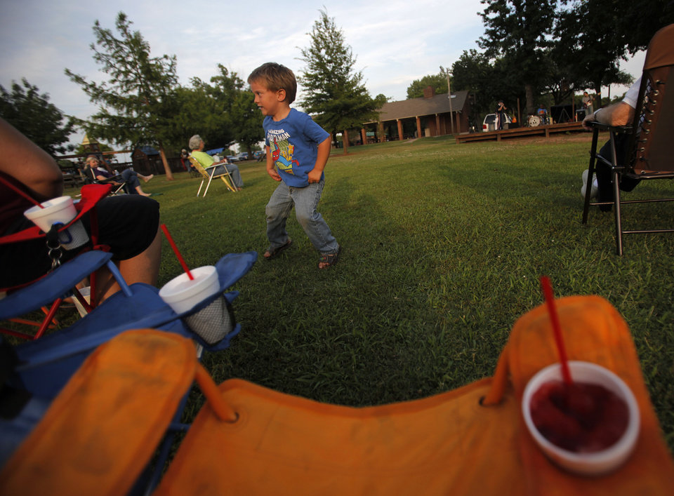 Photo - Trevor Freshour, 3, of Midwest City, dances during the Midwest Twilight Concert in Midwest City on Thursday.  Garett Fisbeck - THE OKLAHOMAN