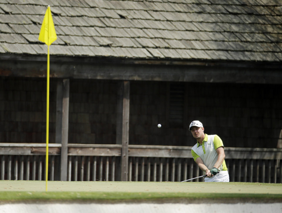 Photo - Jonas Blixt, of Sweden, hits out of a bunker on the 11th fairway during the second round of the Masters golf tournament Friday, April 11, 2014, in Augusta, Ga. (AP Photo/Charlie Riedel)