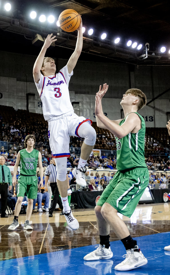 Photo - Hammon's Trey Torrance (3) puts up a shot over Leedey's Nathan Hill (55) during a Class B boys state tournament semi-final basketball game between Hammon vs Leedey in the Jim Norick Arena at State Fair Park in Oklahoma City, Okla. on Friday, March 6, 2020.  [Chris Landsberger/The Oklahoman]