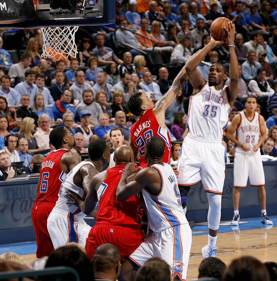Photo - Oklahoma City's Kevin Durant (35) shoots the ball over Matt Barnes (22) during an NBA basketball game between the Oklahoma City Thunder and the Los Angeles Clippers at Chesapeake Energy Arena in Oklahoma City, Wednesday, Nov. 21, 2012. Photo by Bryan Terry, The Oklahoman