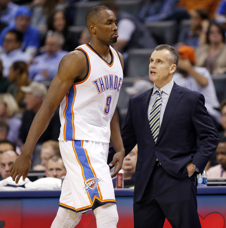 Photo - Oklahoma City coach Billy Donovan talks to Serge Ibaka (9) during an NBA basketball game between the Oklahoma City Thunder and the New York Knicks at Chesapeake Energy Arena in Oklahoma City, Friday, Nov. 20, 2015. New York won 93-90. Photo by Nate Billings, The Oklahoman