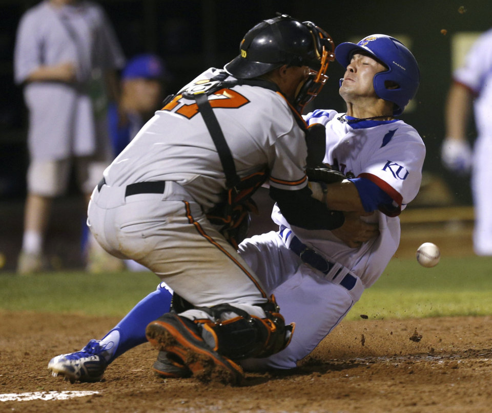 Justin Protacio of Kansas collides with Oklahoma State's Gage Green at home as he scores in the seventh inning of their Big 12 Baseball Championship tournament game at the Chickasaw Bricktown Ballpark in Oklahoma City, Friday, May, 24, 2013. Photo by Bryan Terry, The Oklahoman