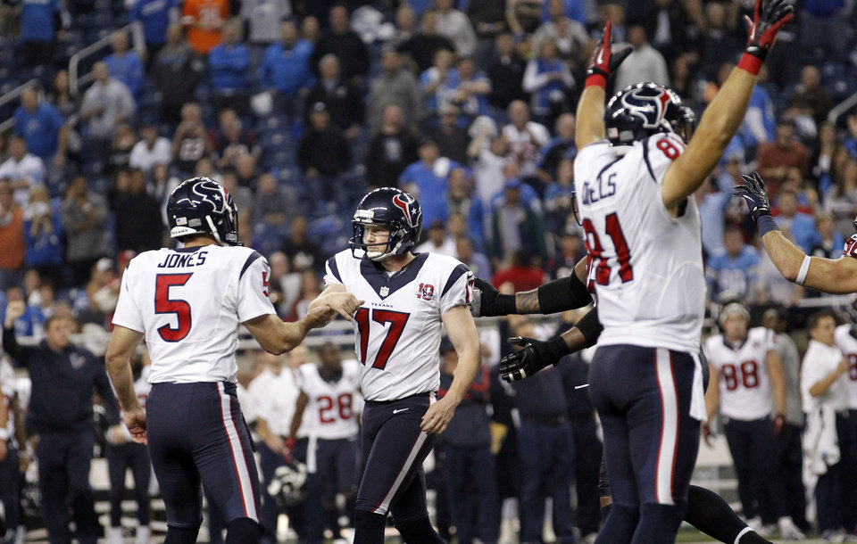 Photo -   Houston Texans kicker Shayne Graham (17) is congratulated by Donnie Jones (5) after kicking the game-winning field goal in overtime of an NFL football game against the Detroit Lions at Ford Field in Detroit, Thursday, Nov. 22, 2012. The Texans won 34-31. At right celebrating is Texans' Owen Daniels. (AP Photo/Rick Osentoski)