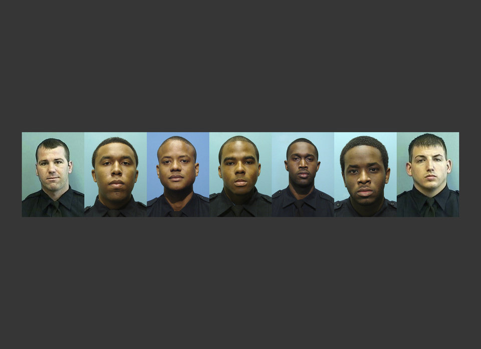 Photo - RETRANSMITTED FOR IMAGE SIZE - These undated photos provided by the Baltimore Police Department show, from left, Daniel Hersl, Evodio Hendrix, Jemell Rayam, Marcus Taylor, Maurice Ward, Momodu Gando and Wayne Jenkins, the seven police officers who are facing charges of robbery, extortion and overtime fraud, and are accused of stealing money and drugs from victims, some of whom had not committed crimes. (Baltimore Police Department via AP)