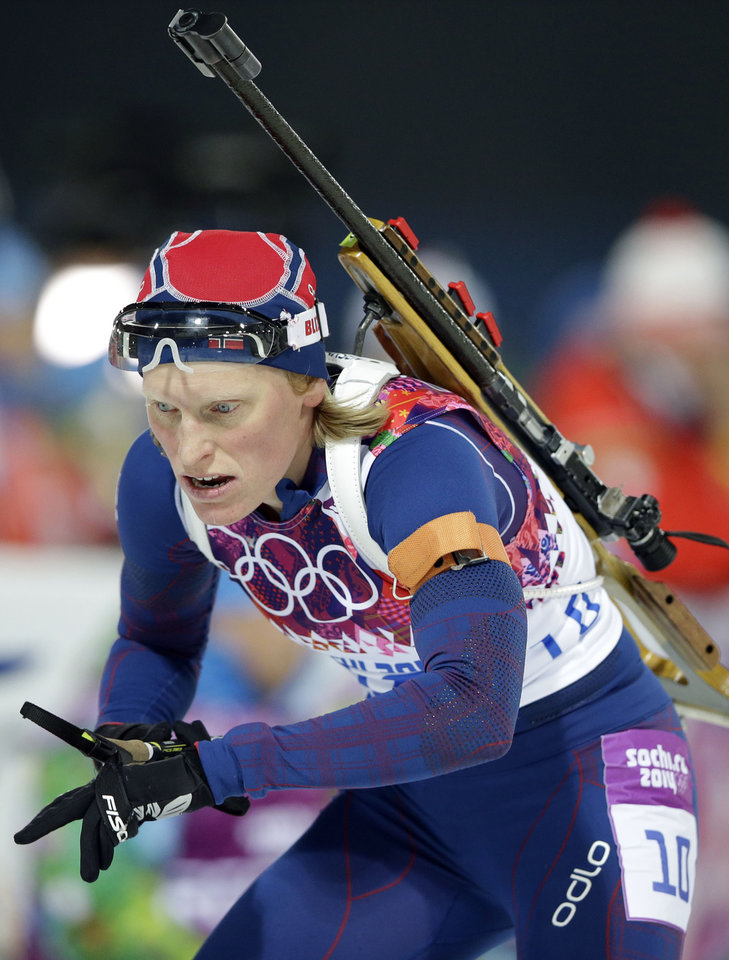 Photo - Norway's Tora Berger approaches the shooting range during the women's biathlon 10k pursuit, at the 2014 Winter Olympics, Tuesday, Feb. 11, 2014, in Krasnaya Polyana, Russia. (AP Photo/Lee Jin-man)