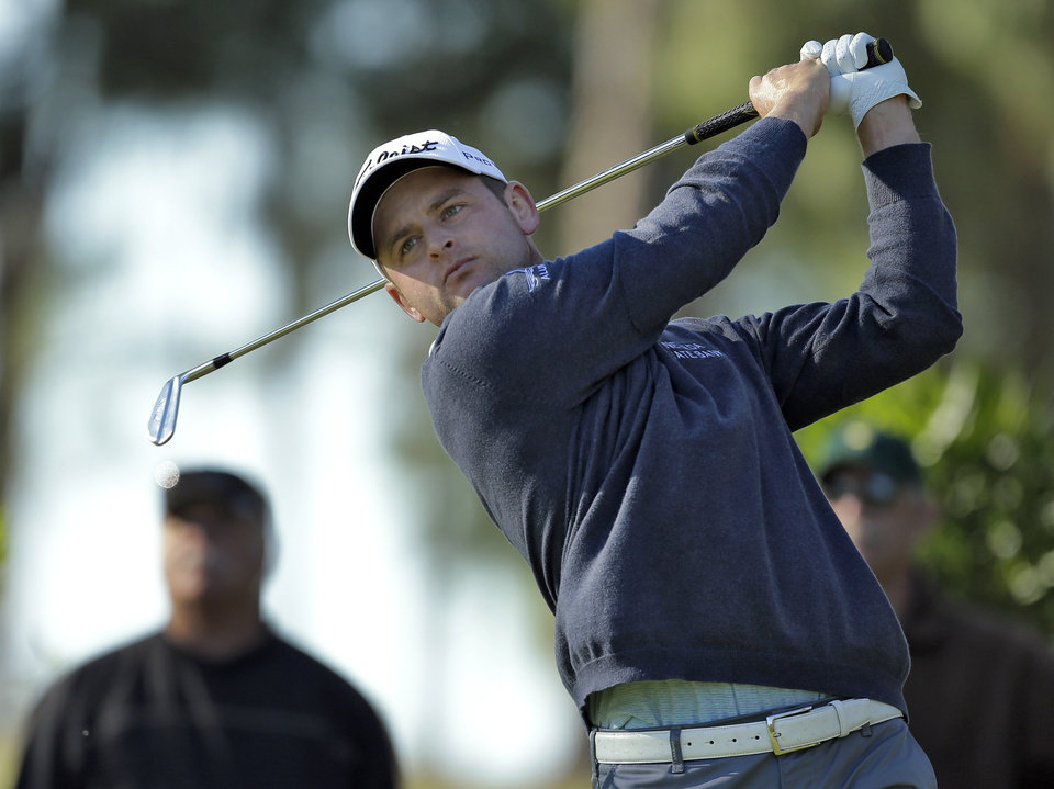 Photo - John Merrick follows the flight of his tee shot on the eighth hole during the first round of the Valspar Championship golf tournament at Innisbrook, Thursday, March 13, 2014, in Palm Harbor, Fla. (AP Photo/Chris O'Meara)